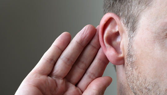 Man with his hand on his ear, as a sign of listening - Contact